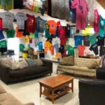 Volunteer lounge featuring tshirts from Camp Restore New Orleans mission trip groups
